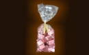 Transparent bag containing 300 gr little gianduiotto pink