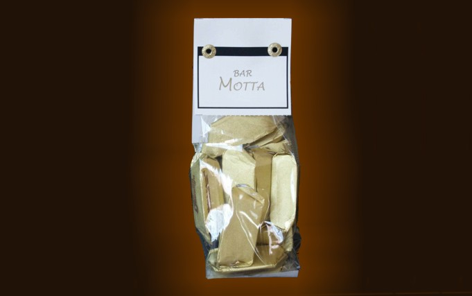 Pvc bag with personalized label containing gr. 100 gianduiotti.